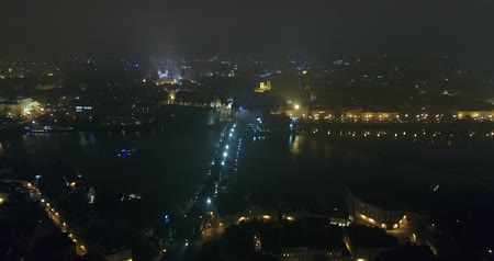 hradcany : Night panorama of Prague, panoramic view from the air to the old town and Charles Bridge, lights of the night city, Prague