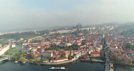 charles bridge : Panoramic view from above on the Prague Castle, aerial of the city, view from above on the cityscape of Prague, flight over the city, top view, top view of Charles Bridge, Vltava River