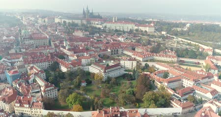 čeština : Panoramic view from above on the Prague Castle, aerial of the city, view from above on the cityscape of Prague, flight over the city, top view, top view of Charles Bridge, Vltava River
