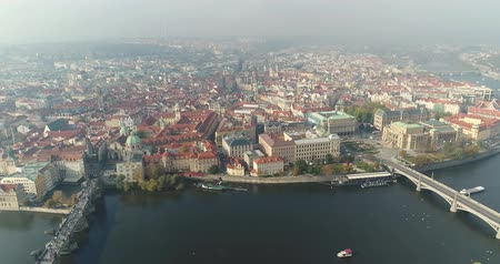 çek cumhuriyeti : Panoramic view from above on the Prague Castle, aerial of the city, view from above on the cityscape of Prague, flight over the city, top view, top view of Charles Bridge, Vltava River