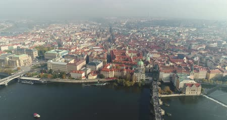 történelmi : Panoramic view from above on the Prague Castle, aerial of the city, view from above on the cityscape of Prague, flight over the city, top view, top view of Charles Bridge, Vltava River
