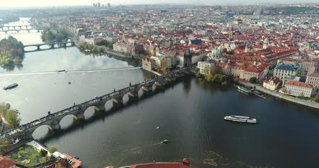 vertically : Panoramic view from above to the city of Prague and Charles Bridge, Vltava River, flight over the Charles Bridge