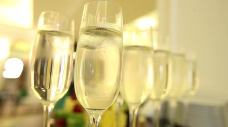 şerefe : Close up of champagne glasses with celebration new year on the background. Stok Video