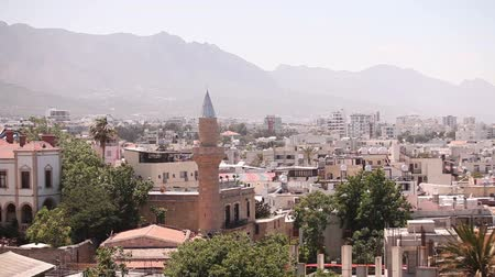 slum house : View of the Arab city by a mosque, The Arab city near the sea, the minaret in the Arab city, the Muslim, the Muslim city, east, Arabian town near the sea, against the backdrop of mountains, top view Stock Footage