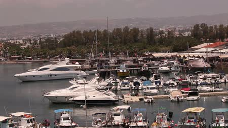 mooring : Cyprus, Greece, Pleasure boats and fishing boats in harbor, fishing boats near the pier, boat parking, A number of fishing boats park near the pier in the port, Panorama, top view, tourism