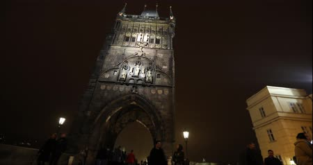 camera rotation : View of the Old Town Tower on the Charles Bridge in Prague, timelapse, Prague Old Town, wide angle, view from the bottom point, timelapse, Prague