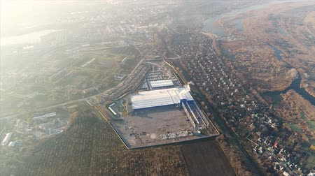 warsztat : Construction of a large factory, Industrial exterior, panoramic view from the air. Construction site, metal structure. construction machinery, Aerial view of the construction Wideo