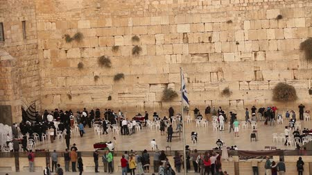 wailing : Jerusalem, Israel, western wall, wailing wall, high angle wide view of jewish men praying and worshiping at the wailing wall wide in jerusalem