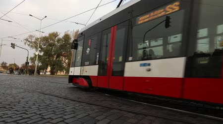 čeština : Streets of a modern city, urban traffic, street of modern Prague, trams and cars on the square, timelapse, Europe