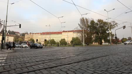 cobbles : Streets of a modern city, urban traffic, street of modern Prague, trams and cars on the square, timelapse, Europe