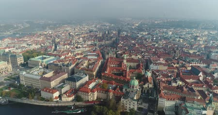 cseh : Panoramic view from above on the Prague Castle, aerial of the city, view from above on the cityscape of Prague, flight over the city, top view, top view of Charles Bridge, Vltava River