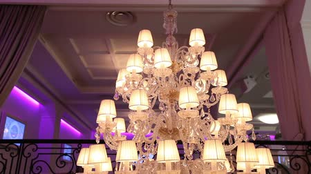 glitters : Vintage chandelier in the restaurant, interior Stock Footage