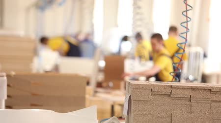 warsztat : Furniture factory workers in yellow overalls collect furniture, Furniture manufacture,, industrial interior,small depth of field