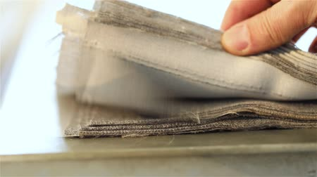 decorador : Samples of fabric for upholstery the furniture, a stack of furniture fabrics on the table, fabric furniture Stock Footage