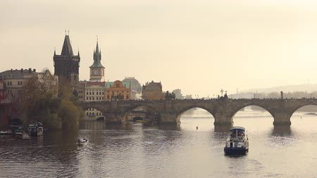 prague bridge : Old bridge over the river. Charles bridge, Prague Stock Footage