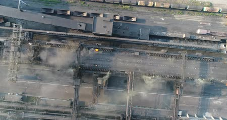 fire facilities : Industrial area top view, View of the industrial object, Courtyard of a factory, Aerial view, Smoke and fire, environmental pollution, environmental pollution, ecological disaster, panoramic view, 4K Stock Footage