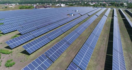 solar : Aerial view to solar power plant. Industrial background on renewable resources theme. flying over rows of solar panels, solar panels, solar panels on the field, top view, View from above, 4K