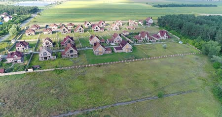 dach : Unfinished cottages, abandoned cottages, a cottage town, several houses, Green lawn, View from above, aerial
