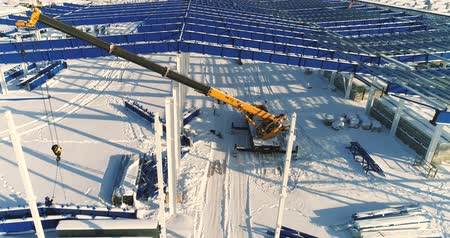 яма : Construction of a modern factory or plant, Industrial area in winter, panoramic view from the air. Modern plant on the snow-covered field, the structural steel structure of a new commercial building