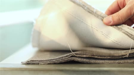 samples of fabric : Samples of fabric for upholstery the furniture, a stack of furniture fabrics on the table, fabric furniture, business designer hands, close-up, shallow depth of field Stock Footage