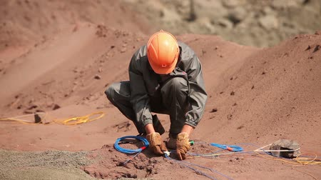 demolition : Preparation of an explosion in the quarry, workers are preparing charges, iron mine, blasting in iron ore quarry, explosion in iron-ore quarry, Industrial exterior Stock Footage