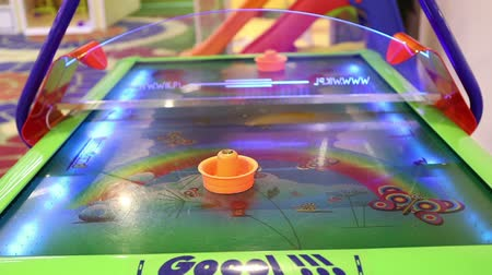 hurl : Air hockey, childrens playroom slots, childrens entertainment, Games For Children Stock Footage