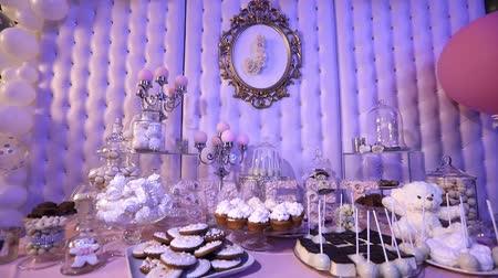 souffle : Candy bar in the restaurant, childrens party, a white teddy bear with a butterfly on her neck, lit candle, teddy bear on a table Candy bar, close-up, Candy bar design, design Candy Bar