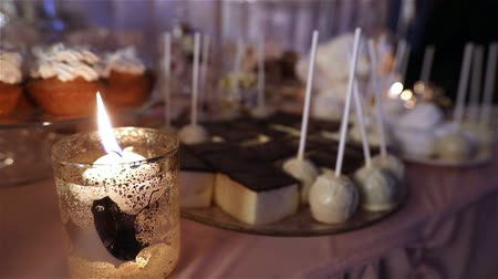banquete : Candy bar in the restaurant, childrens party, birthday, lighted candle, burning candle in a candlestick on a table, Candy bar in the background, Candy bar design of the restaurant, design Candy Bar