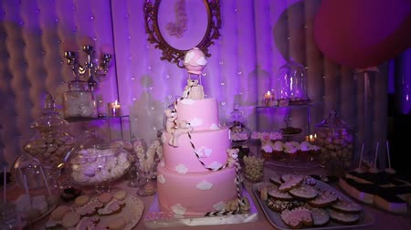 milestone : Table with sweets, Pink cake 1 year, Candy bar, Delicious sweets on candy buffet, cake with a bear cub, Dark, childrens birthday, Pink bear