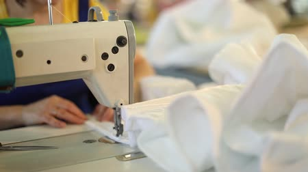 szycie : A woman works at a sewing factory, tailoring, dressmaking, sewing machine