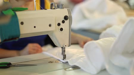 szycie : A woman works at a sewing factory, tailoring, dressmaking, sewing machine, sewing of covers