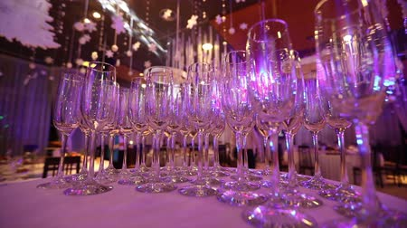 goblet : Empty glasses for champagne on the buffet table in the restaurant hall, buffet table, restaurant interior, glasses for champagne Stock Footage