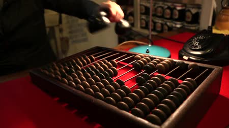aritmética : Man calling the old phone, wooden abacus in the office Vídeos