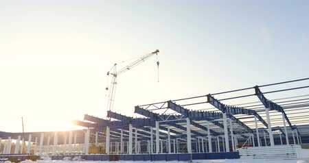 warsztat : Modern storehouse construction site, the structural steel structure of a new commercial building against a clear blue sky in the background, Construction of a modern factory or warehouse