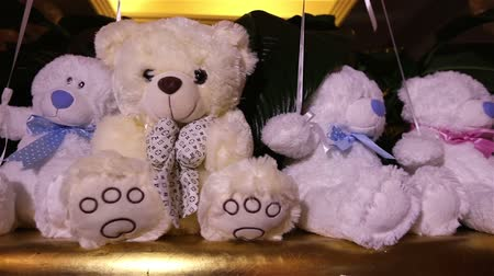 мягкость : Teddy bears sitting in a row, white teddy bears, helium balloons, cute teddy bear with a butterfly on her neck, soft toy, Interior halls for childrens birthday, a gift, a room, indoors, Teddy bear