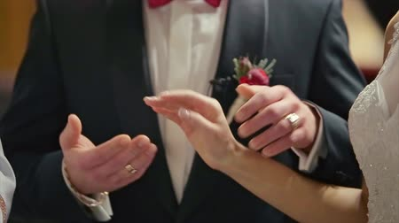 casamento : Groom Wears Wedding Ring on Womans Hand Bride Ceremony flower