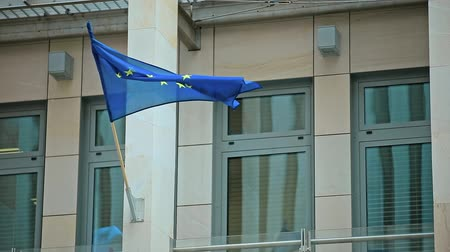 ue : Waving Flag of European Union on Building.