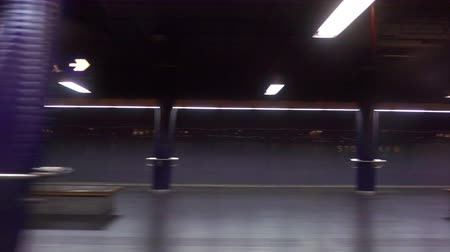 approaching subway : Train arriving at an underground station at night. View from the train. Dolly shot Stock Footage