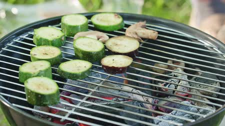 vegetable marrows : Barbecue grill. Grilling marrows and mushrooms. Close-up shot