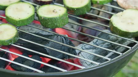 vegetable marrows : Barbecue grill. Grilling marrows and mushrooms. Close-up macro shot