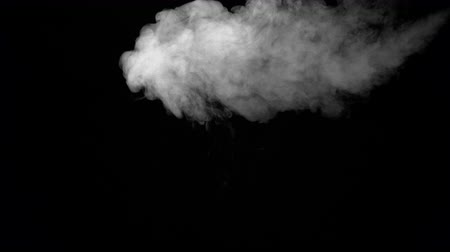evaporate : White water vapour on a black background. Close-up shot