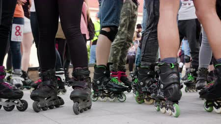 roller blading : Lublin, Polland - May 2017: Many legs in roller-blades. Low angle shot