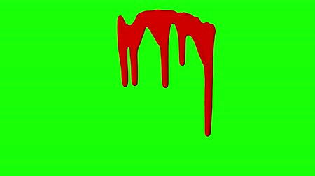 kurulamak : Red ink dripping over green screen background. Close-up shot Stok Video