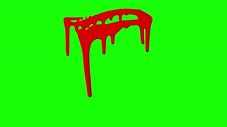 splashed : Red ink dripping over green screen background. Close-up shot Stock Footage