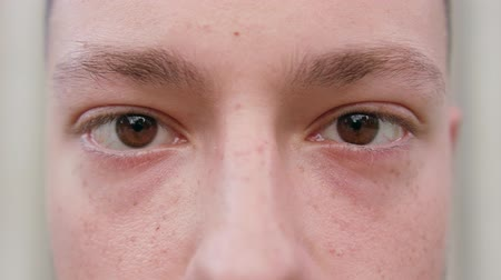 szempilla : A close-up of a young mans eyes. Macro close-up shot Stock mozgókép