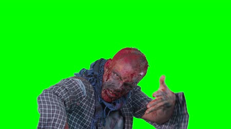 korkunç : Halloween theme horrible scary zombie in clothes dance and want to catch you isolated over green screen background