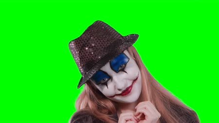 promover : The girl clown rub fingers and smile, isolated over green screen background Stock Footage