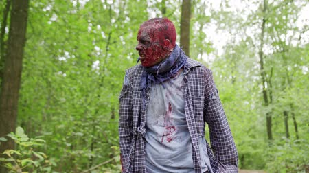 grim : Zombies male are walking through the woods. Stock Footage