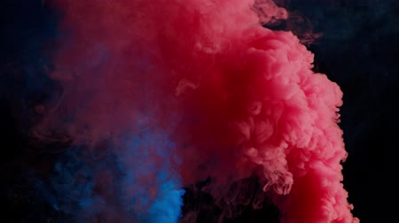 pink and blue bomb smoke on black background