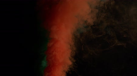 fontain : orange and green bomb smoke on black background Stock Footage
